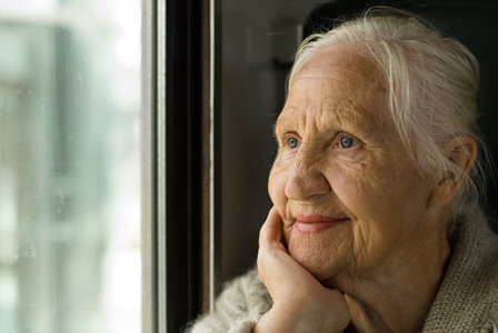Older lady staring at window